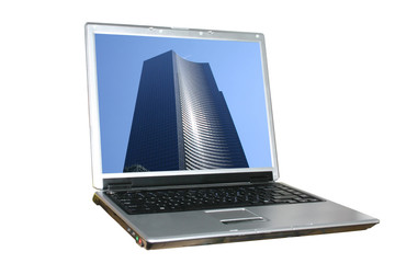 isolated laptop with skyscraper on its screen