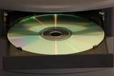 cd in tray desktop poster