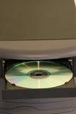 cd in tray desktop vertical poster