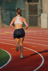 girl running in jog bra