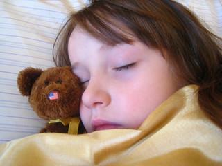 fast asleep with teddy bear