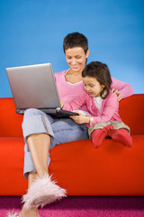 mother and douther with laptop