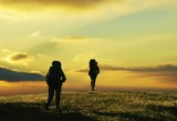 people going on sunset in trekking poster