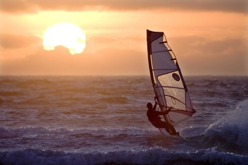 windsurfer and setting sun