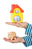 house and moneybox in hands poster