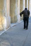 elderly man walking the street poster