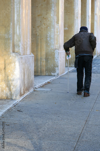elderly man walking the street