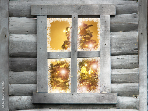 wooden lodge window with christmas tree