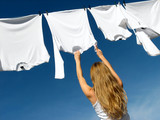 longhaired girl, blue sky and white laundry poster