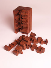 wooden puzzle in walnut with missing pieces