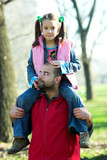 little pretty child on father shoulder poster