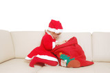 little santa with red sack full of presents poster
