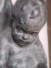 bronze cherubic baby statue