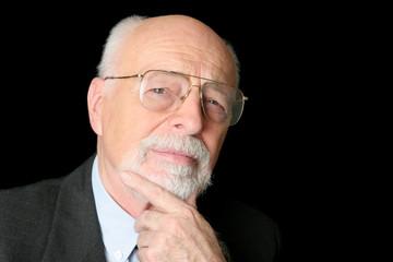 stock photo of a skeptical senior man