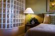 condo bedroom & glass block shower