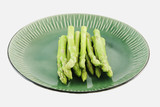 fresh asparagus shoots on a plate poster