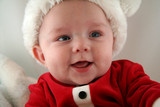 baby boy in santa claus outfit poster