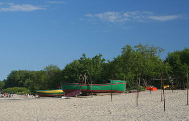 two old boats docked on the beach