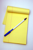 notepad and a pen poster
