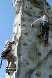 people climbing on artificial rock wall