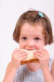 little girl eating sandwich poster