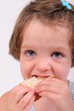 little girl eating sandwich isolated over white poster