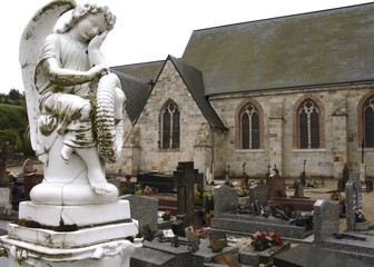 an angel watching over the church and cemetary