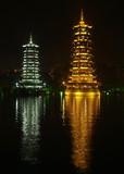 twin pagoda at at night poster