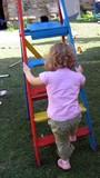 girl /child playing/climbing ladder poster