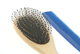 comb and brush on white poster