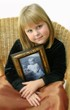 child with photo of great grandmom
