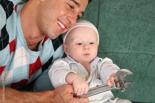 father with baby with extension wrench