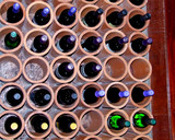 wine rack with bottles poster