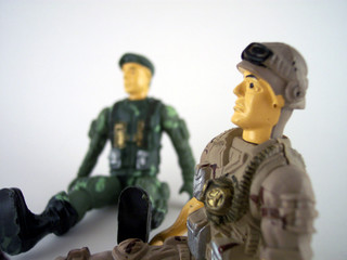 two sitting toy soldiers