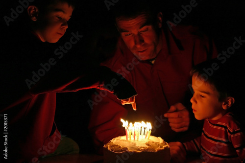 boy pointing at birthday candles