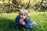 boy on a lawn poster