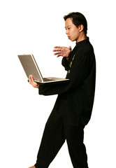kung fu boy screw with laptop
