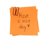 two post-it notes with handwritten have a nice day poster