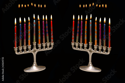 pair of menorahs on black