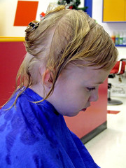 girl at the beauty shop with a blue smock
