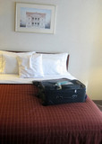 luggage in hotel room poster