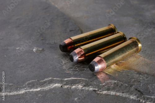 pistol bullets on slate