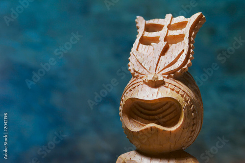 tiki statue on blue background