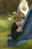 a boy lying on a slide poster