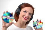 woman with headphones holding cds poster
