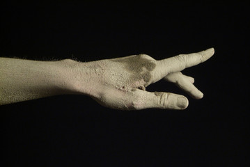 hand and mud