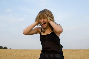 pretty girl shouting outdoors
