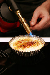 creme brulee with blowtorch