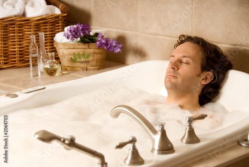 Leinwanddruck Bild man in a bath