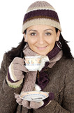attractive lady sheltered for the winter drinking a tea cup poster